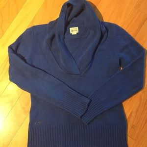 Warm and comfortable blue sweater with high collar